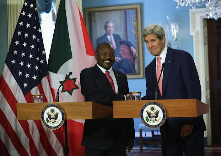 Pierre Nkurunziza (left) with U.S. Secretary of State John Kerry at the Department of State August 4, 2014 in Washington, DC (AFP Photo/Alex Wong)