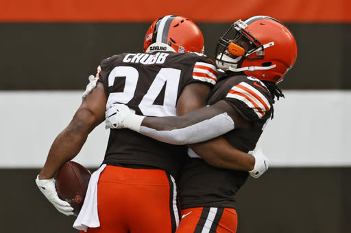 Cleveland Browns running back D'Ernest Johnson (30) hugs running back Nick Chubb (24) after Chubb rushed for a 47-yard touchdown during the first half of an NFL football game against the Pittsburgh Steelers, Sunday, Jan. 3, 2021, in Cleveland. (AP Photo/Ron Schwane)