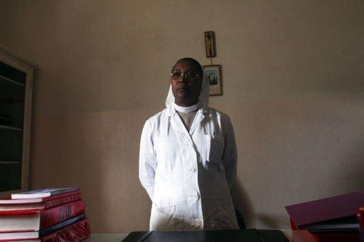 "Marie Amelie, the main doctor at the hospital of the congregation ""The Little Servants of the Sacred Heart of Jesus"" stands in her office in Moramanga. Madagascar follows an eight-month treatment regime that requires daily medical supervision for the first 60 days, and the WHO has persuaded it to adopt a six-month regime, the health ministry said"