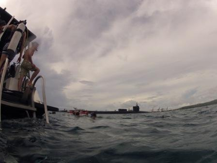 USC students complete a dive in May 2012 on Western Shoals reef as the nuclear submarine USS Michigan transits by the adjacent reef that would be dredged to accommodate an aircraft carrier. Photo by Kaitlin Mogentale