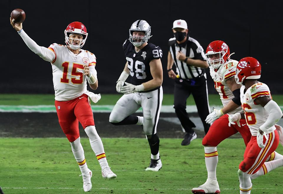 LAS VEGAS, NEVADA - NOVEMBER 22:  Quarterback Patrick Mahomes #15 of the Kansas City Chiefs throws a pass pressured by defensive end Maxx Crosby #98 of the Las Vegas Raiders during the NFL game at Allegiant Stadium on November 22, 2020 in Las Vegas, Nevada. The Chiefs defeated the Raiders 35-31.  (Photo by Christian Petersen/Getty Images)