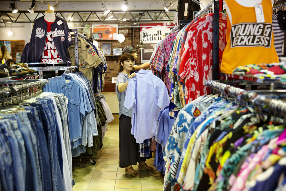 A women looking at second hand clothing at a second hand shop. (Photo: Jonas Gratzer/LightRocket via Getty Images)