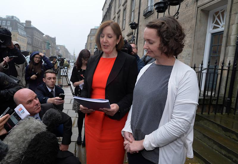 Ebola nurse Pauline Cafferkey (right) stands outside the Nursing and Midwifery Council in Edinburgh as her legal representative Joyce Cullen reads a statement after she was cleared of professional misconduct by a panel following a probe into her return to the UK with the virus.