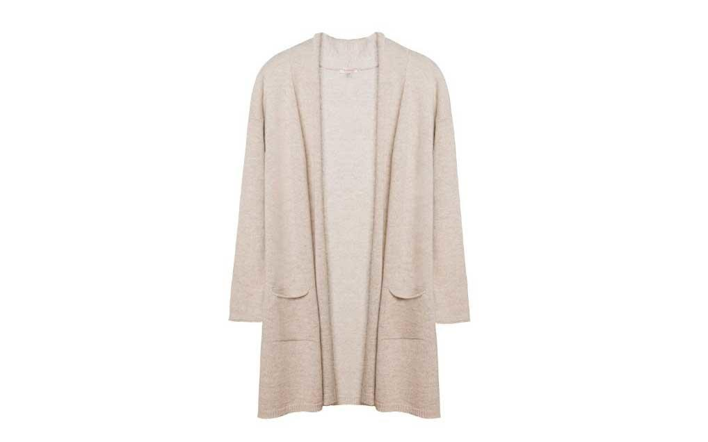 "<p>Knitted in Italy, this almost-too-soft cashmere cardi is the epitome of a layering piece. We rarely travel without one. </p> <p>To buy: <a href=""http://cuyana.64ud.net/c/249354/651670/10312?subId1=TL%2CGiftsforWomenWhoLovetoTravel%2Cwarrenj%2CGIF%2CGAL%2C456134%2C201911%2CI&u=https%3A%2F%2Fwww.cuyana.com%2Fopen-cashmere-cardigan.html%3Fint_source%3Dpairitwith%23beige"" target=""_blank"">cuyana.com</a>, $225</p>"