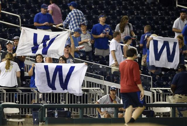 Chicago Cubs fans wave the W flag after beating the Nationals in ten innings. (AP)