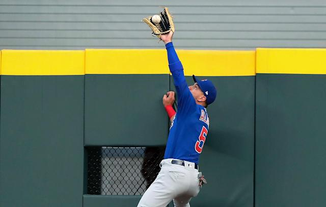 Albert Almora made a leaping, unlikely catch on Tuesday to save what might have been a home run smoked off the bat of Tyler Flowers. (AP)