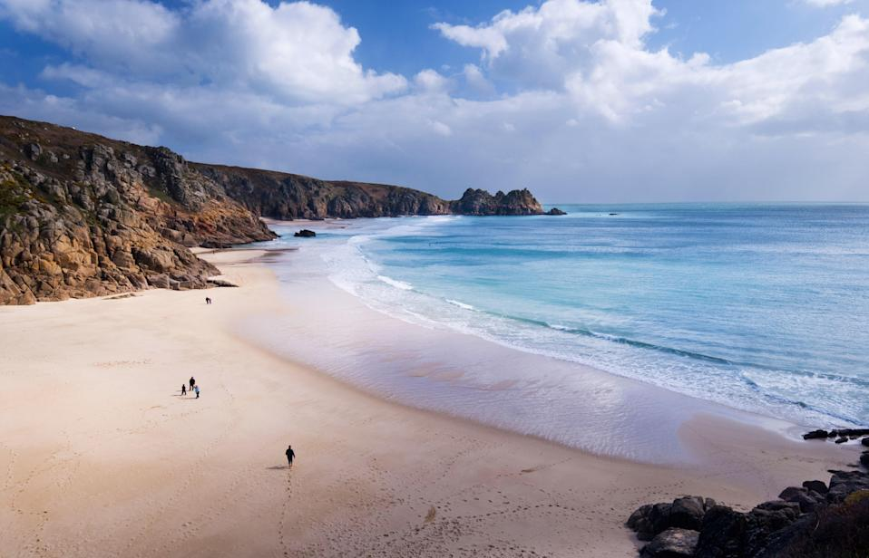 """Dazzling turquoise water and silky golden sand aren't usually the first things that come to mind when you think of England. But that's exactly what you'll find at Porthcurno Beach in Cornwall, five hours' drive from the heart of <a href=""""https://www.cntraveler.com/destinations/london?mbid=synd_yahoo_rss"""" rel=""""nofollow noopener"""" target=""""_blank"""" data-ylk=""""slk:London"""" class=""""link rapid-noclick-resp"""">London</a>. The beach is sheltered by high granite cliffs and is set within a protected bay, so expect soft breezes and gentle rolling waves, perfect for wading."""