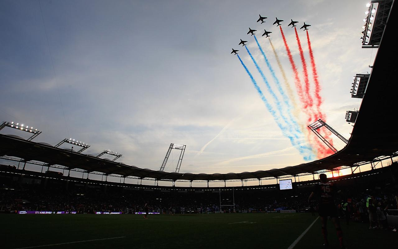TOULOUSE, FRANCE - JUNE 02: The Patrouille de France fly over the Stade de Toulouse before the start of the match during the French Top 14 Semi Final match between Toulouse and Castres Olympique at Stade de Toulouse on June 2, 2012 in Toulouse, France. (Photo by Matthew Lewis/Getty Images) ***BESTPIX***