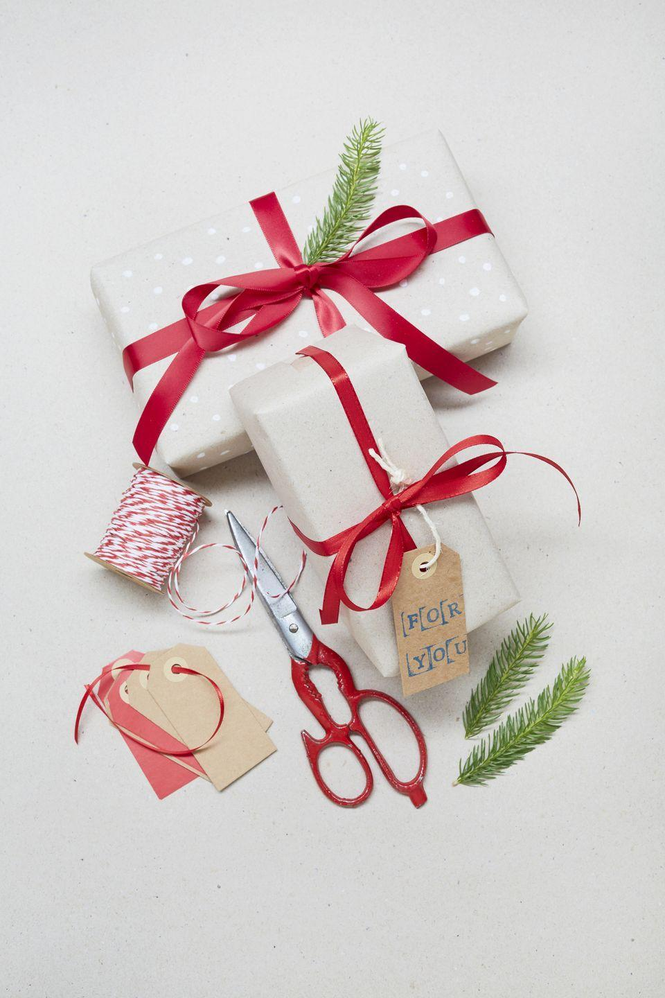 """<p>Here's a fun way to make quick work of wrapping <em>all those presents </em>under the tree: Grab a timer and see which family member can wrap the most gifts in the shortest amount of time. Up the stakes by imposing a """"one hand only"""" rule. </p><p><a class=""""link rapid-noclick-resp"""" href=""""https://www.amazon.com/Hallmark-Reversible-Christmas-Wrapping-Holidays/dp/B01M2UWPSZ?tag=syn-yahoo-20&ascsubtag=%5Bartid%7C10072.g.33643974%5Bsrc%7Cyahoo-us"""" rel=""""nofollow noopener"""" target=""""_blank"""" data-ylk=""""slk:SHOP WRAPPING PAPER"""">SHOP WRAPPING PAPER</a><br></p>"""