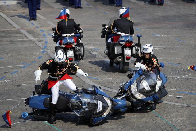 <p>Two police motorcycles crash during a demonstration as part of the Bastille Day parade on the Champs-Élysées in Paris, France, Saturday, July 14, 2018. (Photo: Francois Mori/AP) </p>