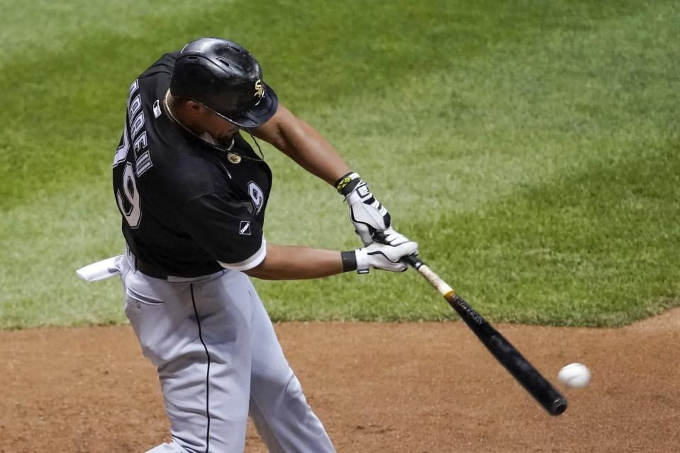 Chicago White Sox's Jose Abreu hits an RBI single during the seventh inning of a baseball game against the Milwaukee Brewers Tuesday, Aug. 4, 2020, in Milwaukee. (AP Photo/Morry Gash)