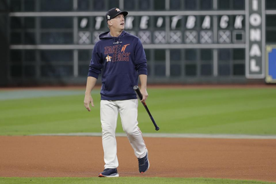 FILE - In this Oct. 30, 2019, file photo, Houston Astros manager AJ Hinch watches batting practice before Game 7 of baseball's World Series against the Washington Nationals in Houston. The Detroit Tigers have hired AJ Hinch to be their new manager, giving him a chance to return to a major league dugout after he was fired by Houston in the wake of the Astros' sign-stealing scandal. (AP Photo/David J. Phillip, File)
