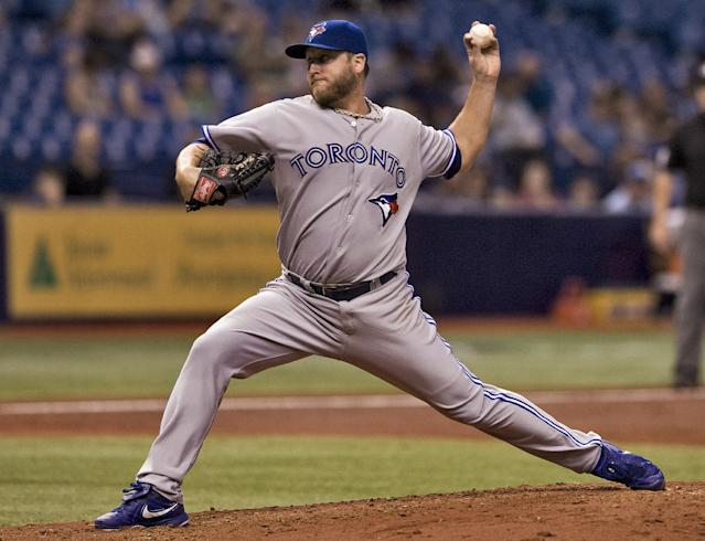 Toronto Blue Jays starter Mark Buehrle pitches against the Tampa Bay Rays during the third inning of a baseball game Thursday, Sept. 4, 2014, in St. Petersburg, Fla. (AP Photo/Steve Nesius)