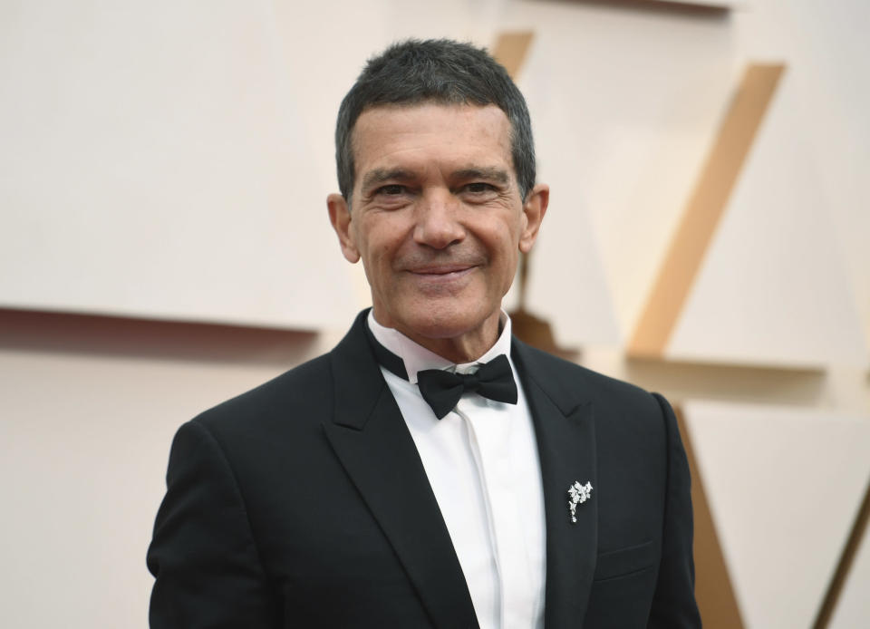 FILE - Antonio Banderas arrives at the Oscars in Los Angeles on Feb. 9, 2020. Banderas says he's tested positive for COVID-19 and is celebrating his 60th birthday in quarantine. The Spanish actor announced his positive test on Instagram on Monday. (Photo by Richard Shotwell/Invision/AP, File)
