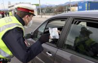 Police check people who want to leave Wiener Neustadt, Austria, Saturday, March 13, 2021. The city of Wiener Neustadt near Vienna may only be left with a negative COVID-19 coronavirus test. (AP Photo/Ronald Zak)