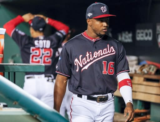 Washington Nationals' Victor Robles waits for the start of Game 3 of the baseball National League Championship Series against the St. Louis Cardinals Monday, Oct. 14, 2019, in Washington. (AP Photo/Jeff Roberson)