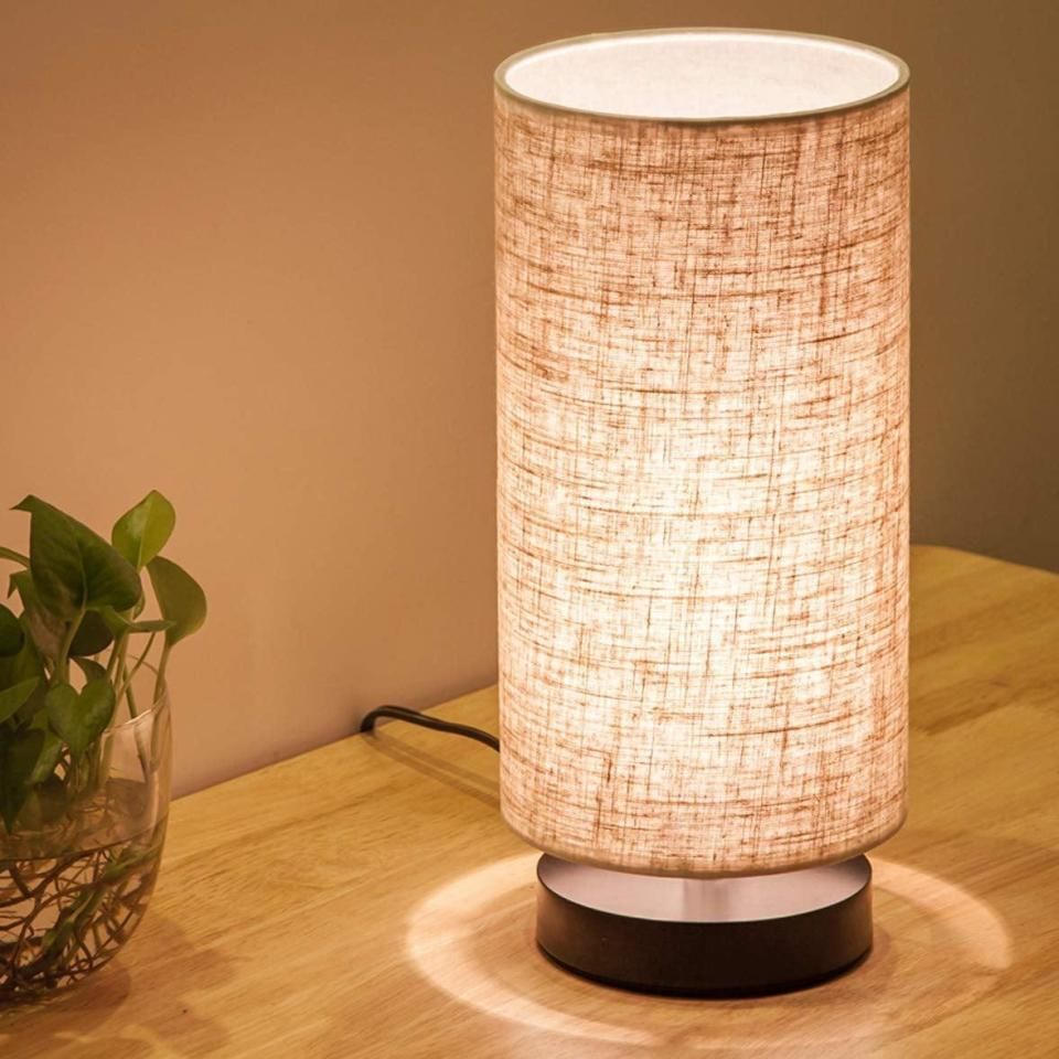 <p>We love the long shade on this rustic <span>Lifeholder Table Lamp</span> ($21).</p>