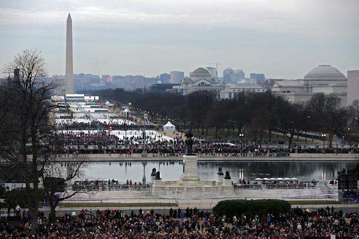 <p>Supporters gather on the National Mall to watch the presidential inauguration on January 20, 2017 in Washington, DC. (Photo: Chip Somodevilla/Getty Images) </p>