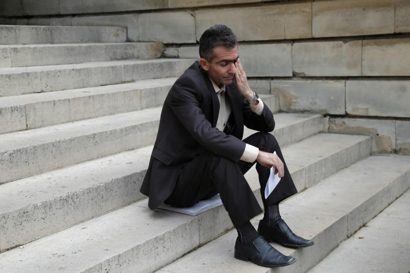 Kamil Abdulqadir Wais Mohammed, sits on the steps of Paris court, as he arrives at court to file a legal complaint in Paris, Monday, June 10, 2013. Twenty victims of the Saddam Hussein's 1988 chemical weapons attack on the Kurdish town of Halabja are demanding a French judicial investigation into companies that supplied the materials. Halabja marked the deadliest chemical weapons attack against civilians. Saddam suspected the non-Arab Kurds of siding with Iran in the Iran-Iraq war. Up to 5,000 people died in the March 1988 attack. (AP Photo/Francois Mori)