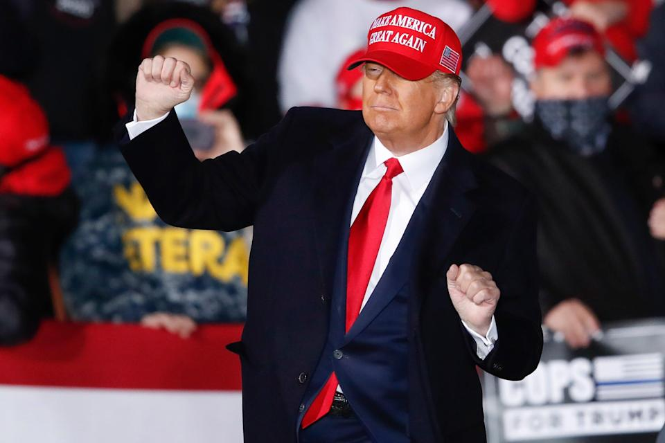 Donald Trump dances on stage after speaking during a campaign rally in Janesville, Wisconsin on Saturday (EPA)