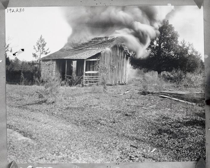 A home burns on Jan.9, 1923, during a white mob's attacks on the Black community of Rosewood,Fla.