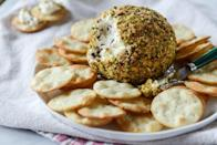 """<p>Give the classic cheese ball appetizer a Thanksgiving twist with dried cranberries, roasted garlic, and chopped nuts. It's great when served with crackers! </p><p><a href=""""https://www.thepioneerwoman.com/food-cooking/recipes/a82126/pistachio-goat-cheese-ball/"""" rel=""""nofollow noopener"""" target=""""_blank"""" data-ylk=""""slk:Get the recipe."""" class=""""link rapid-noclick-resp""""><strong>Get the recipe.</strong></a></p>"""