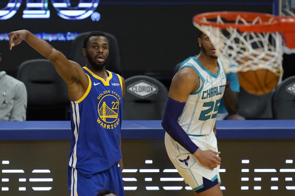 Golden State Warriors forward Andrew Wiggins (22) watches his three-point basket next to Charlotte Hornets forward P.J. Washington (25) during the second half of an NBA basketball game in San Francisco, Friday, Feb. 26, 2021. (AP Photo/Jeff Chiu)