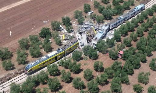 Italy station master 'accepts partial blame' for train crash
