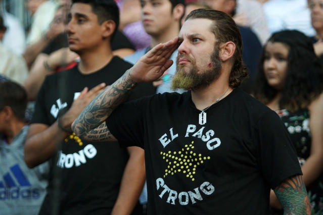 A man salutes during a memorial service for the victims of the Aug. 3 mass shooting, Wednesday, Aug. 14, 2019, at Southwest University Park, in El Paso, Texas. (AP Photo/Jorge Salgado)