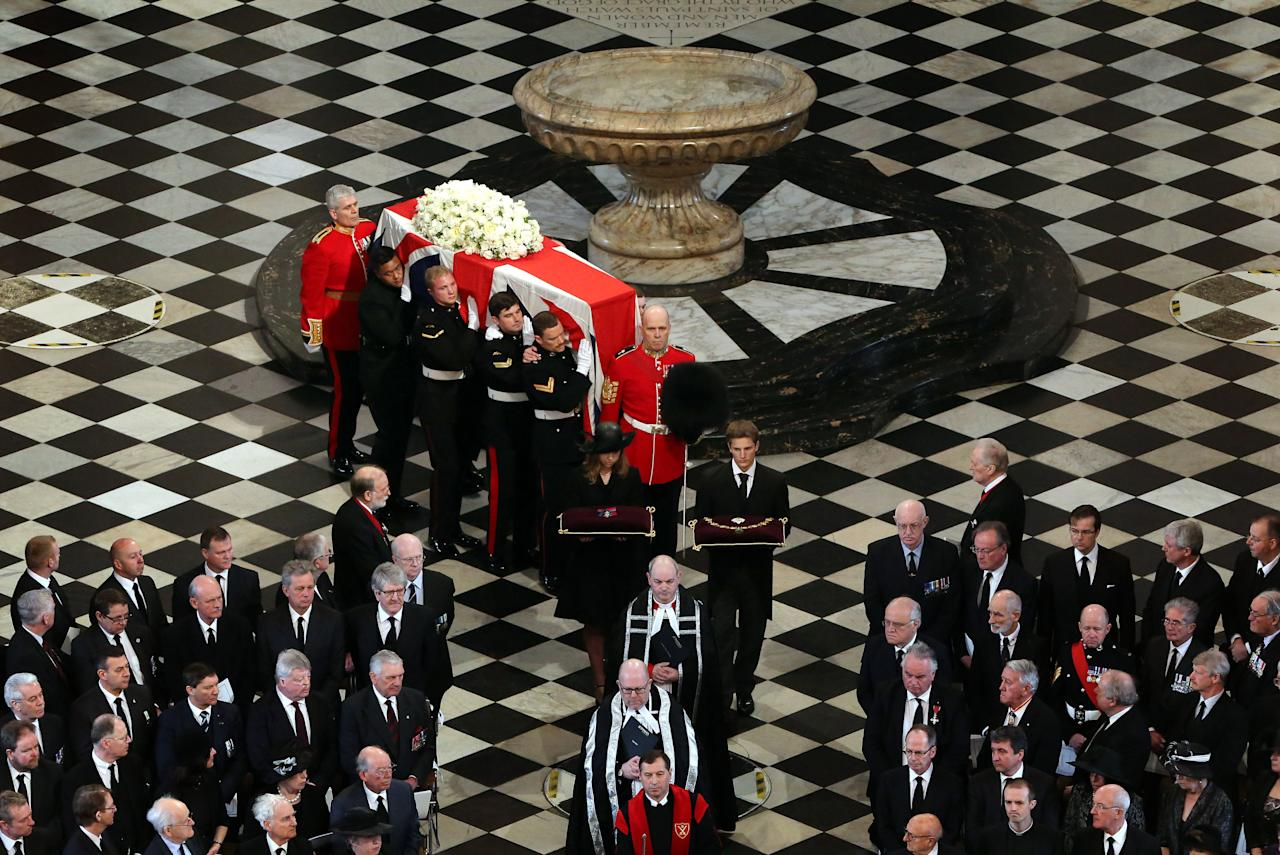 The coffin arrives for the funeral service of former Prime Minister Baroness Thatcher, at St Paul's Cathedral, central London Wednesday April 17, 2013. Margaret Thatcher, Britain's Iron Lady, was laid to rest Wednesday with a level of pomp and protest reflecting her status as a commanding, and polarizing, political figure. (AP Photo/Gareth Fuller, pool)