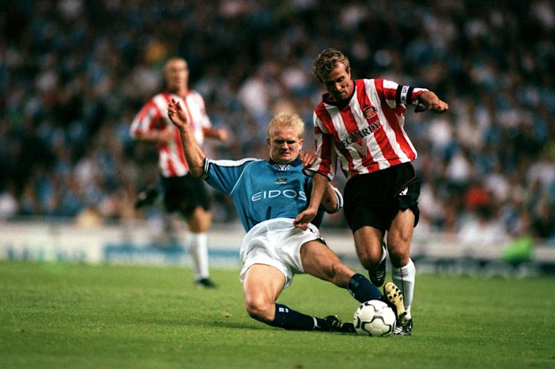 Manchester City's Alf Inge Haaland (l) tackles Sunderland captain Michael Gray (r) (Photo by Matthew Ashton/EMPICS via Getty Images)