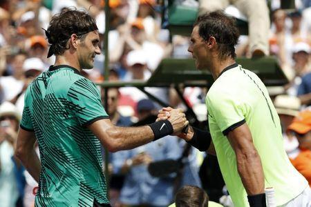 Apr 2, 2017; Key Biscayne, FL, USA; Roger Federer of Switzerland (L) shakes hands with Rafael Nadal of Spain (R) after their match in the men's singles championship of the 2017 Miami Open at Crandon Park Tennis Center. Mandatory Credit: Geoff Burke-USA TODAY Sports
