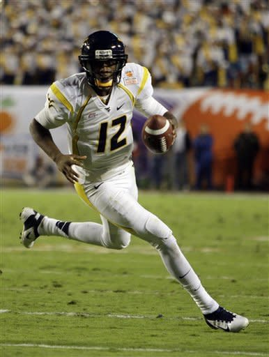West Virginia quarterback Geno Smith (12) runs for a first down during the first half of the Orange Bowl NCAA college football game against Clemson, Wednesday, Jan. 4, 2012, in Miami. (AP Photo/Lynne Sladky)