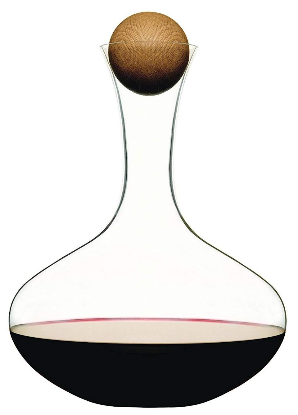 <p>This sleek, modern <span>Sagaform Wine Carafe With Oak Stopper</span> ($40) is a great gift.</p>