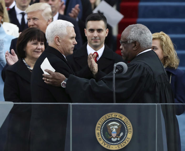 <p>Vice President Mike Pence (L) shakes hands with Justice Clarence Thomas (R) after being sworn in during inauguration ceremonies swearing in Donald Trump as the 45th president of the United States on the West front of the U.S. Capitol in Washington on Jan. 20, 2017. (Photo: Carlos Barria/Reuters) </p>