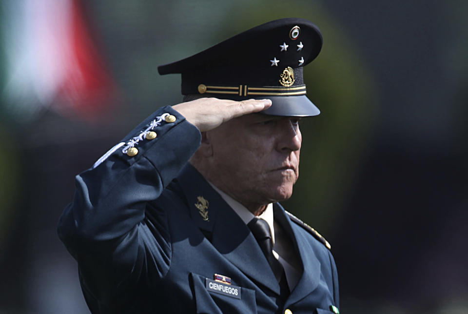 FILE - In this April 16, 2016 file photo, Mexico's Defense Secretary Gen. Salvador Cienfuegos Zepeda salutes soldiers at the Number 1 military camp in Mexico City. Mexico's Foreign Relations Secretary Marcelo Ebrard wrote in his Twitter account Thursday, Oct. 15, 2020, that U.S. Ambassador Christopher Landau had informed him that Gen. Cienfuegos has been arrested in Los Angeles. (AP Photo/Marco Ugarte, File)