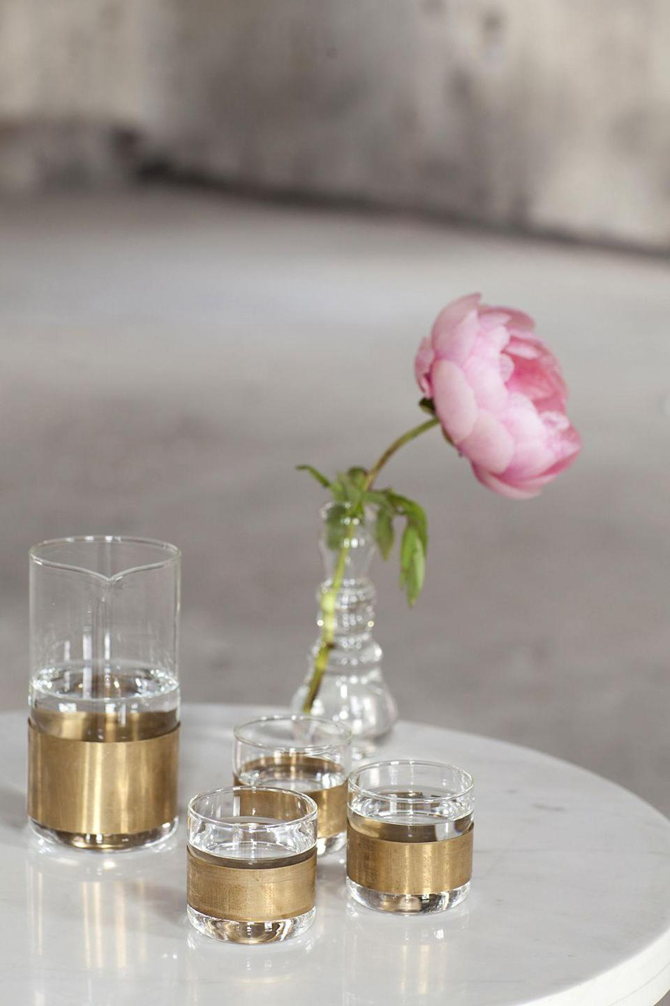 """<p><strong>Raise a glass</strong></p><p>Forget cut crystal, the only way to glam up your drinks receptacles is with brass. Whether you use them for Bloody Marys or mojitos, these brass tumblers and carafe will certainly put a stylish twist on your tipple of choice.</p><p>Brass and glass carafe, £29 and tumblers, £15 each, <a href=""""http://www.rockettstgeorge.co.uk/brass-and-glass-carafe-tumblers-sold-separately-39301-p.html"""" rel=""""nofollow noopener"""" target=""""_blank"""" data-ylk=""""slk:rockettstgeorge.co.uk"""" class=""""link rapid-noclick-resp"""">rockettstgeorge.co.uk</a></p>"""