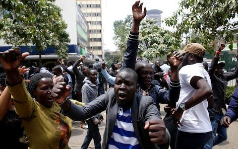 Celebrations in downtown Nairobi after a re-election is called - Credit: BAZ RATNER/Reuters