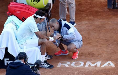 FILE PHOTO: Tennis - ATP 1000 - Italian Open - Foro Italico, Rome, Italy - May 16, 2019 Switzerland's Roger Federer receives medical attention during his third round match against Croatia's Borna Coric REUTERS/Matteo Ciambelli