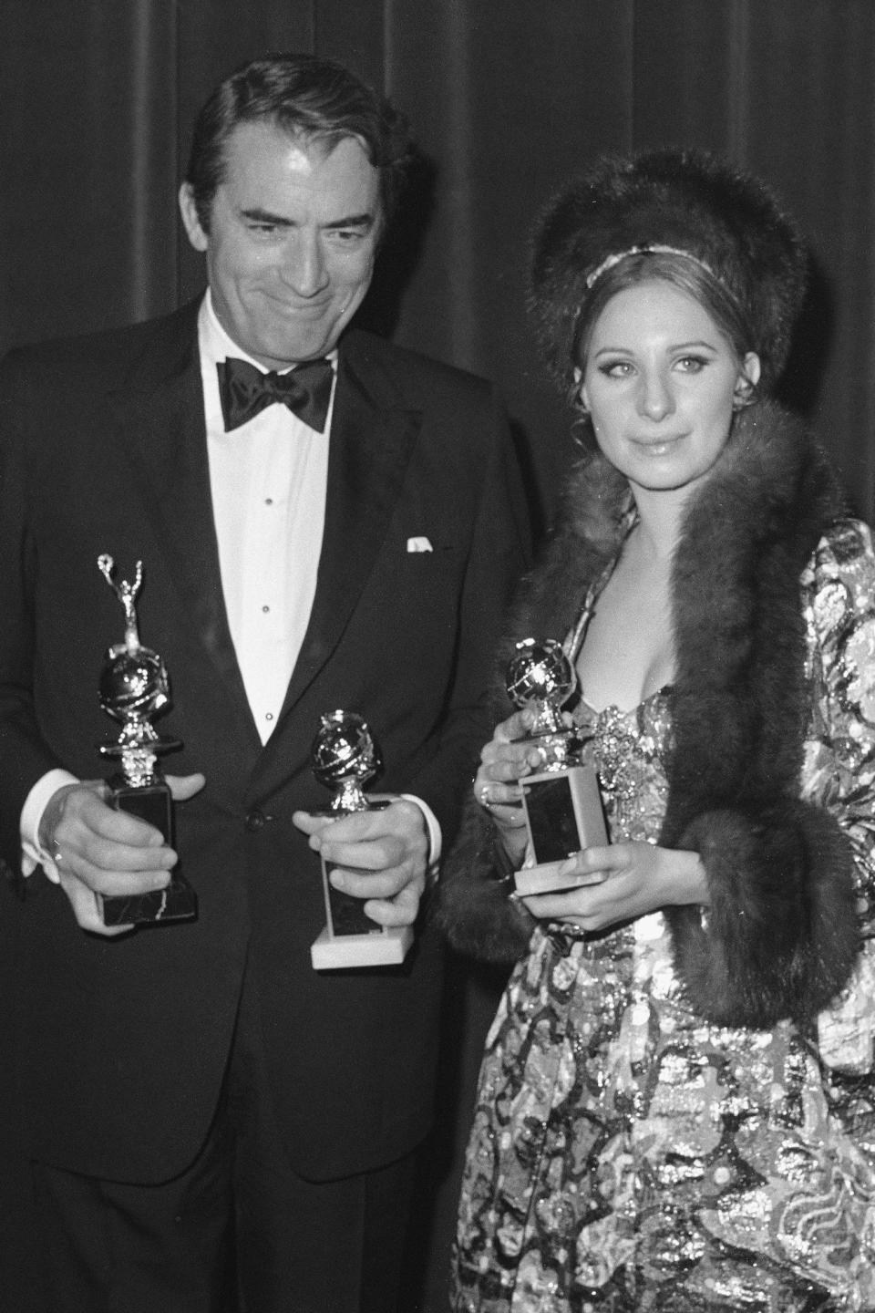 <p>Gregory Peck (left) won the Cecil B. DeMille Award in 1969.</p>