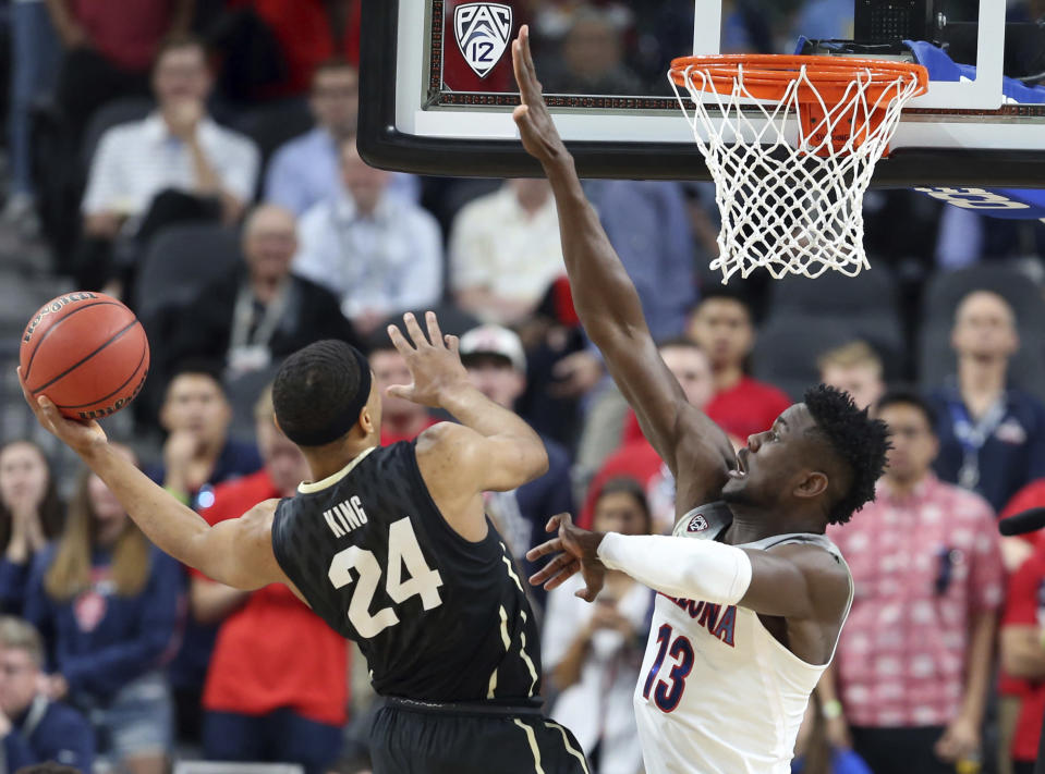 Colorado's George King (24) shoots as Arizona's Deandre Ayton defends during the first half of an NCAA college basketball game in the quarterfinals of the Pac-12 men's tournament Thursday, March 8, 2018, in Las Vegas. (AP Photo/Isaac Brekken)