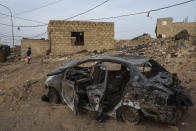 The damaged car belonging to 32-year-old Taher Farag and his two-year-old daughter Liyan Taher, who were both killed on June 5, 2021 from a ballistic missile and an explosive-laden drone fired by Yemen's Houthi rebels hitting a fuel station in the Rawdha neighborhood of the central city of Marib, Yemen, Sunday, June 20, 2021. (AP Photo/Nariman El-Mofty)
