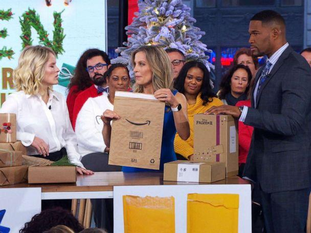 PHOTO: ABC News' Becky Worley shows Amazon's recyclable shipping envelope to Sara Haines and Michael Strahan on 'Good Morning America' on Dec. 10, 2019. (ABC News)