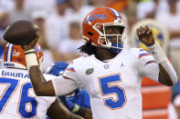 Florida quarterback Emory Jones looks to throw a pass during the first half of an NCAA college football game against Kentucky in Lexington, Ky., Saturday, Oct. 2, 2021. (AP Photo/Michael Clubb)