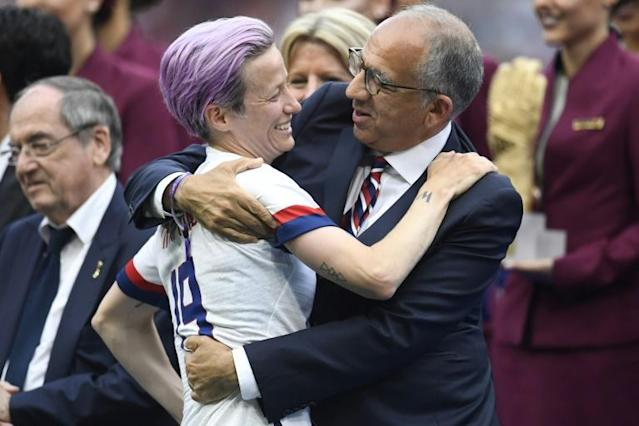 US Football Federation President Carlos Cordeiro hugs Megan Rapinoe, co-captain of the World Cup winning US football team that is suing the federation for equal pay with male players (AFP Photo/CHRISTOPHE SIMON)