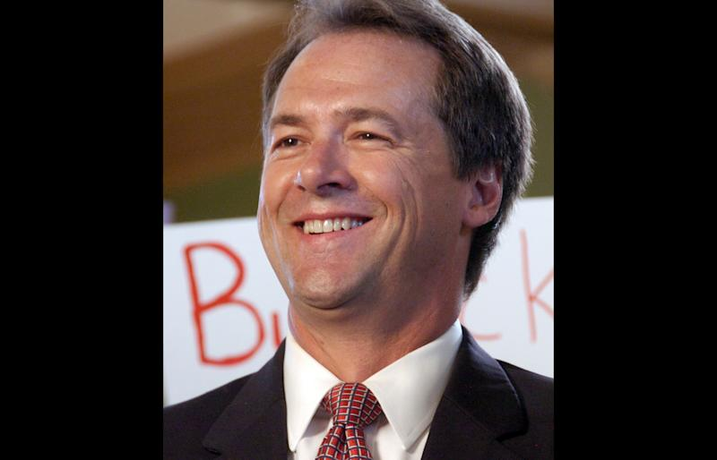 FILE - Montana Attorney General Steve Bullock is seen at an event in which he announced the start of his 2012 gubernatorial campaign on in this Sept. 7, 2011 file photo taken in Billings, Mont. Twenty-two states and the District of Columbia are backing Montana in its fight to prevent the U.S. Supreme Court's 2010 Citizens United decision from being used to strike down state laws restricting corporate campaign spending. Bullock argues that political corruption in the Copper King era led to the state ban on corporate campaign spending. A clarification of Citizens United is needed to make clear that states can block certain political spending in the interest of limiting corruption, he said. On Friday, May 18, 2012 Montana's case was given a boost when U.S. Sens. John McCain, R-Ariz., and Sheldon Whitehouse, D-D-R.I., signed on in support.   (AP Photo/Matthew Brown, File)