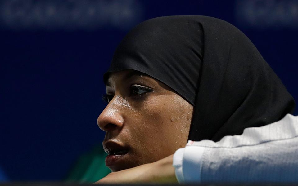 Ibtihaj Muhammad of the United States watches her teammates compete with Russia in a women's team sabre fencing semifinal at the 2016 Summer Olympics in Rio de Janeiro, Brazil, Saturday, Aug. 13, 2016. (AP Photo/Andrew Medichini)