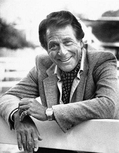 """FILE - Veteran actor Efrem Zimbalist, Jr., known for his starring roles in """"77 Sunset Strip"""" and """"The FBI,"""" stands outside his home, in this Feb. 16, 1982 file photo taken in Los Angeles, Calif. Zimbalist, the son of famous musicians who gained television stardom in the 1950s-60s hit """"77 Sunset Strip"""" and later """"The FBI,"""" died Friday at his ranch in Solvang, Calif., at age 95. (AP Photo/Wally Fong, File)"""