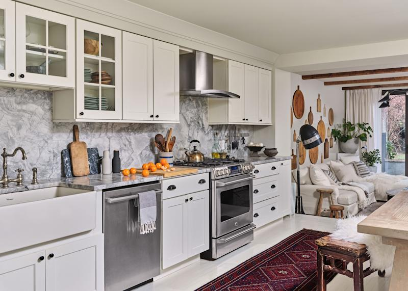The kitchen received minimal renovations but was freshened up with accessories and new hardware.