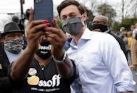 A supporter takes a selfie with Democratic Senate candidate Jon Ossoff